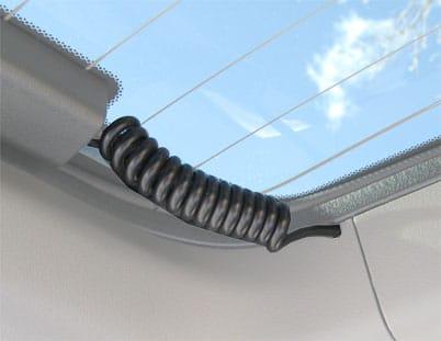 Coil cord for defroster on hatchback flip up glass