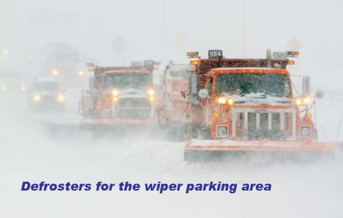 Front windshield defrsoters for the wiper parking area